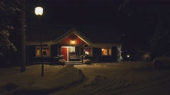 POV. Cozy wooden house in winter forest, at night, Finland. - stock footage