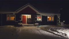 Establishing shot. POV. Cozy wooden house in winter forest, at night, Finland. Stock Footage
