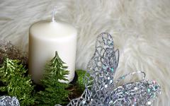 Advent wreath with white candle and glittery butterfly Stock Photos