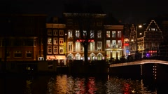 View of the houses and canal in Amsterdam at night Stock Footage
