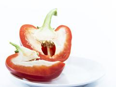 red capsicum sliced with seed inside - stock photo