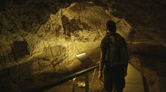 Tourists in cave museum Stock Footage