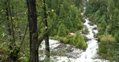 4k Waterfall flowing in the valley,Green conifers,Bomi County,tibet. Stock Footage