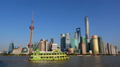 Passenger ships sailing on Huanpu river, seen from the Bund of Shanghai Stock Footage