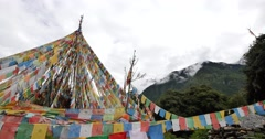 4k prayer flag with snow mountain in tibet. Stock Footage