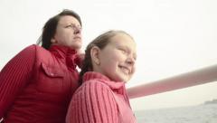 Beautiful green eye mother and daughter, talking, joking, on boat  trip - stock footage