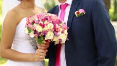 wedding couple are holding bouquet - stock footage