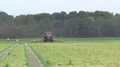 Tractor is turning the grass Stock Footage