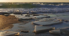 Melted ice floes drifting in winter sea with rolling waves on a background at - stock footage