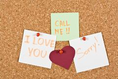i love you note pinned to a cork memory bulletin board. - stock photo