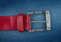 red strap is on denim - stock photo