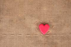 two of hearts on sackcloth - stock photo