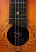 A heart lies on strings the guitar Stock Photos