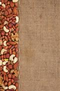 Line, mix nuts  and burlap for the menu Stock Photos