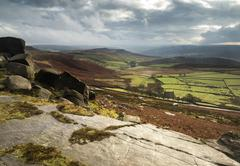 Beautiful late evening autumn light over stanage edge peak district Stock Photos