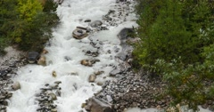 Stock Video Footage of 4k Waterfall flowing in the valley,Green conifers,Bomi County,tibet.