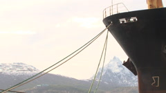 Snowed Mountains with Big Cargo Ship. Ushuaia Port, Argentina Stock Footage