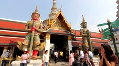 Giant statue Wat Phra Kaew buddha temple bangkok thailand time lapse Stock Footage