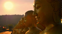 Buddha and the light of the evening sun. Stock Footage