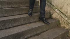 Male feet in nice shoes walking down some stairs Stock Footage