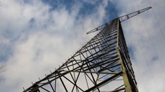 Many clouds are flying over an electricity pylon Stock Footage