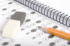 Test score with pencil, notebook and eraser Stock Photos