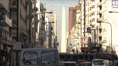 Corrientes Avenue with Obelisk landmark in the background, in Buenos Aires city Stock Footage
