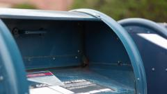 Putting Mail in Post Office Box Stock Footage