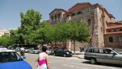 Road traffic near Church of Hagios Demetrios in Thessaloniki, Greece Stock Footage