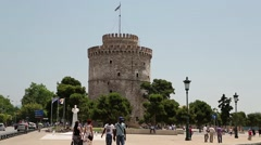 White tower and people on the waterfront in Thessaloniki, Greece Stock Footage