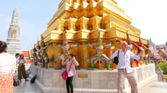 Tourists take pictures for fun. Wat Phra Kaew buddha temple thailand time lapse Stock Footage