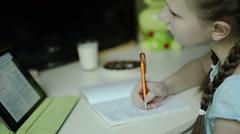 Little blonde ponytail white skin girl study lesson using tablet white desk Stock Footage