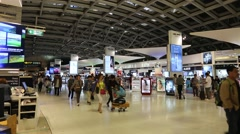 People in duty free area inside Bangkok international airport in Thailand Stock Footage
