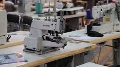 Stitching machines at clothing factory Stock Footage