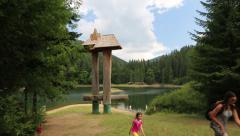 People at lake Synevyr in Carpathian Mountains, Ukraine Stock Footage
