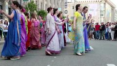 Women in Hindu traditional colorful costumes, dancing on the street Stock Footage