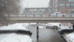 Cars crossing bridge in snow storm Stock Footage