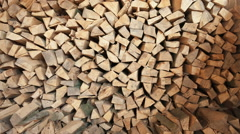 Pile of chopped fire wood prepared for winter - dolly motion Stock Footage