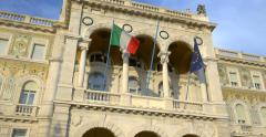 Trieste Italy city center architecture Governement house flags EU flag italian Stock Footage