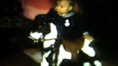 Child on rocking horse Stock Footage