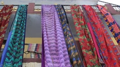 Colorful saris drying on the street and swaying in the wind. Devprayag, India - stock footage