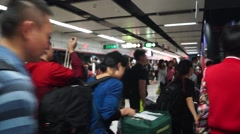 The Shenzhen subway station: people returning from Hongkong shopping Stock Footage