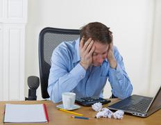 mature man showing frustration while working - stock photo