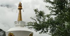 4k tibet buddhist white stupa,cloud cover mountain. Stock Footage