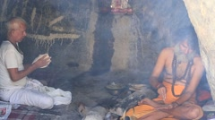 Indian sadhu, holy man in the holy cave near the Ganges river. Devprayag, India Stock Footage