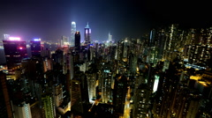 Time Lapse of Hong Kong Skyline and Victoria Harbor at Night - Hong Kong China Stock Footage