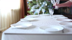 Young woman serves a festive table Stock Footage