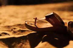 bride shoes on sand night time . - stock photo