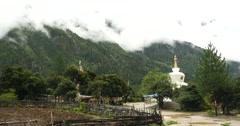 4k tibet people walking around buddhist white stupa in village. Stock Footage