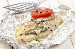 Baked pangasius in tin foil Stock Photos